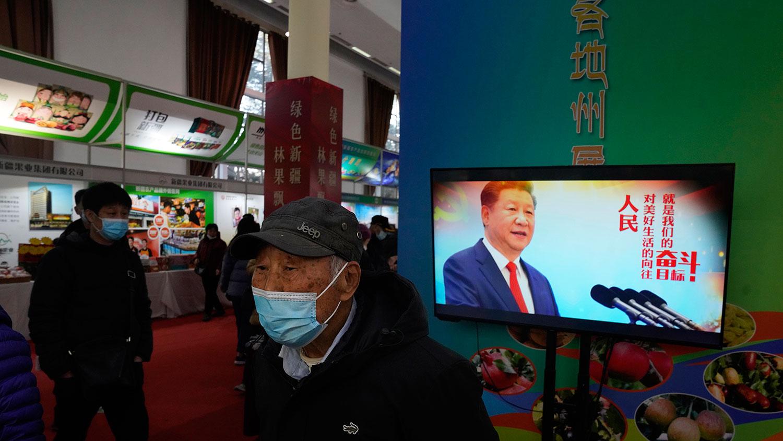 农产品北京博览会上,展示中国国家主席习近平宣传标语。